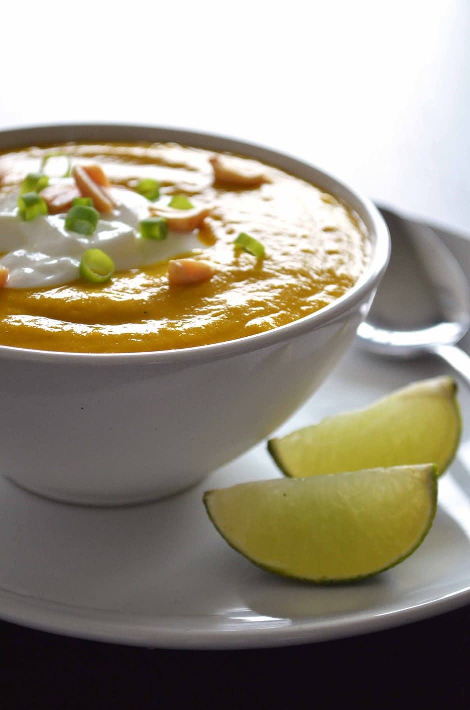 Recipe for spicy pumpkin and coconut soup. Delicious, filling, healthy and easy to make! Via That Healthy Kitchen