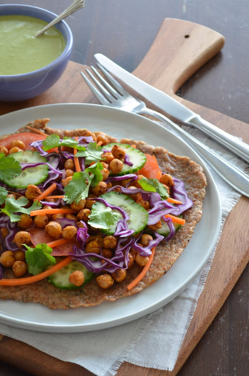 These Rainbow Chickpea Wraps are filled with deliciously spiced roasted chickpeas and wrapped in a warm, home-made flatbread with garlic and herbs. Simply delicious!