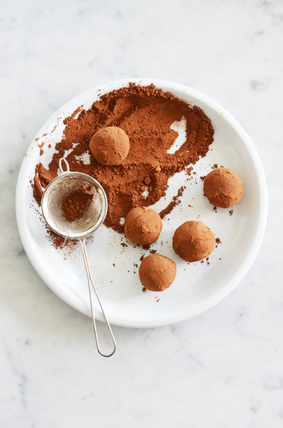 Three ingredient, whole food, healthier chocolate truffles by That Healthy Kitchen. Dairy free, gluten free and vegan too!