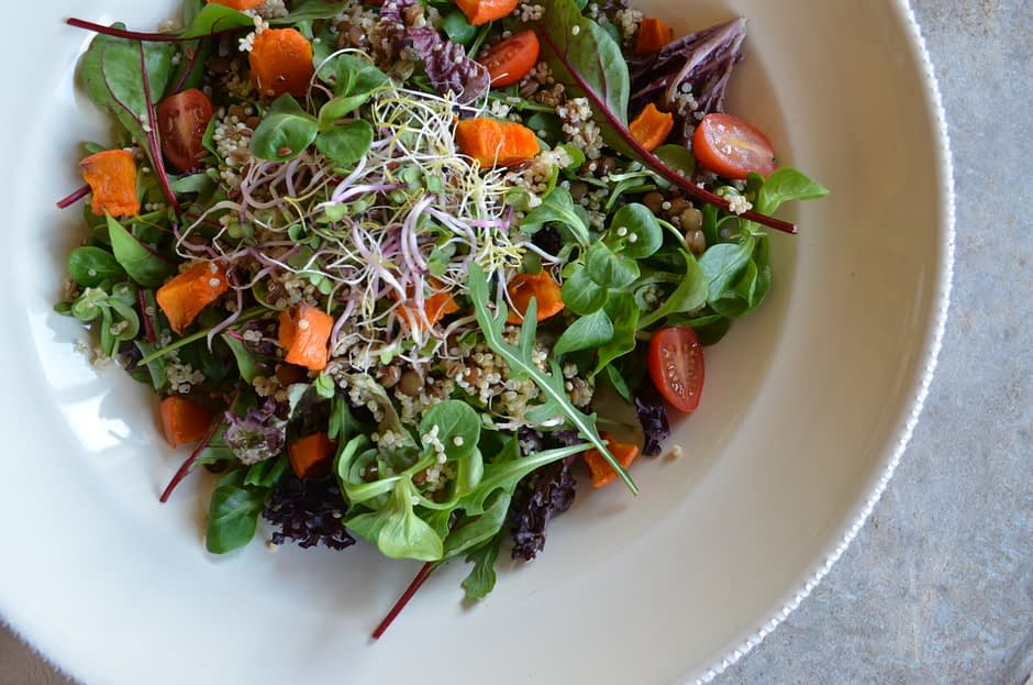 A photo of a big bowl with a simple salad veggie bowl with lentils. Recipe by That Healthy Kitchen