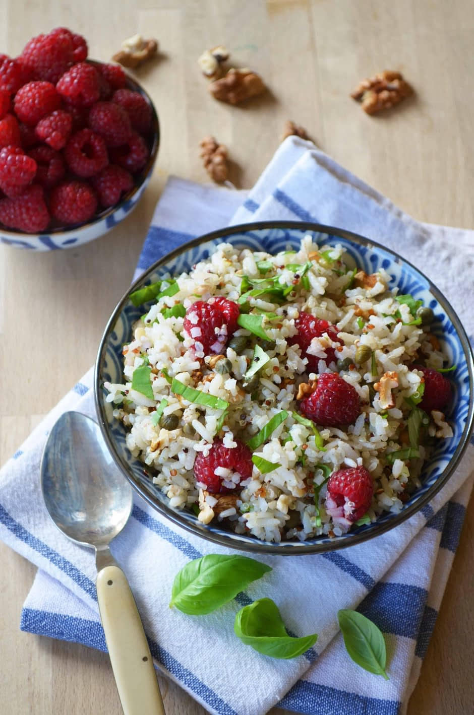 Bowl of grain salad with raspbberries, basil and walnuts. Recipe and photo by That Healthy Kitchen
